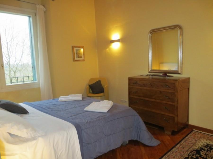 camera matrimoniale appartamento arredato per famiglie Palladio