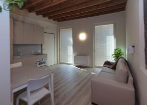 loft L1 zona giorno con cucina e divano